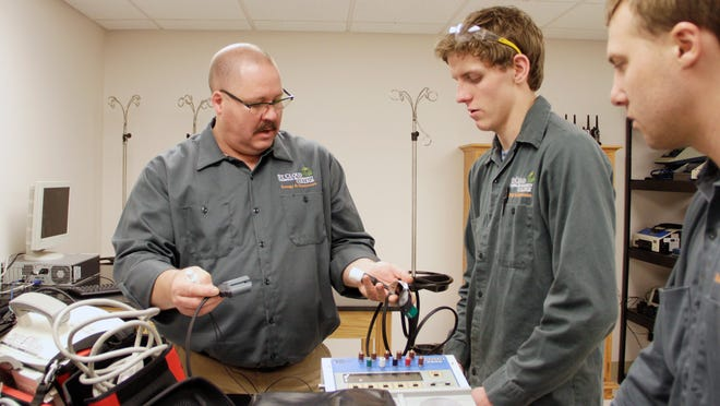 Danny Feldhege instructs <137>some - lss <137>other students who are new to the biotechnician program April 28 at St. Cloud Technical & Community College. Feldhege will be the first graduate of the program in December.