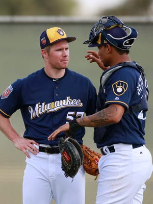 Brewers starting pitcher Chase Anderson talks with catcher Christian Bethancourt.