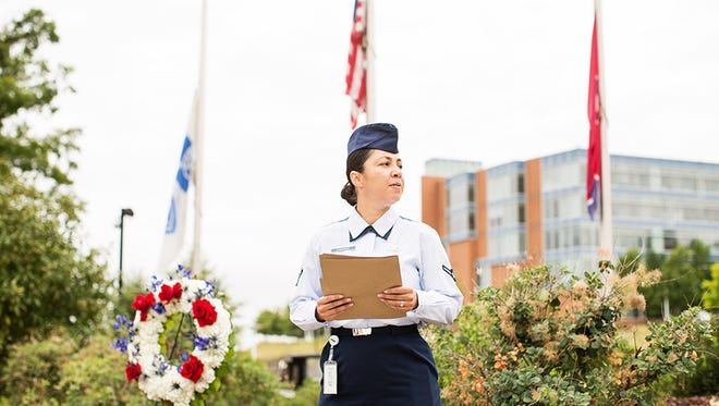 Heather Simmons observes a moment of silence while honoring the servicemen killed at a pair of Chattanooga military facilities in July of 2015.