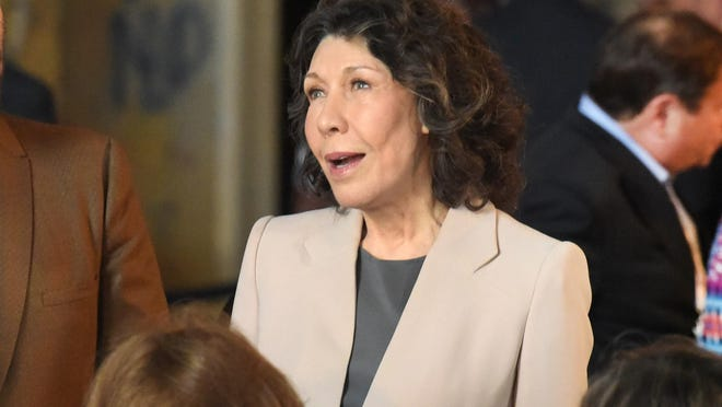 Lily Tomlin talks with guests as she prepares to receive a key to the city. She's one of just four celebrities to receive it.