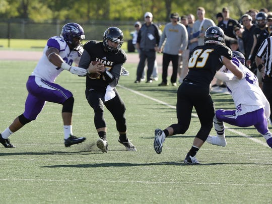 UW-Oshkosh's Jayden Essman runs the ball against UW-Whitewater.  Fifteenth ranked UW-Oshkosh beat number one ranked UW-Whitewater 10 to 7 ending the Warriors 36 game winning streak.  The game was tied at the half and UW-Oshkosh hit a field goal in the fourth quarter to give them the win at J.J. Keller Field at Titan Stadium.