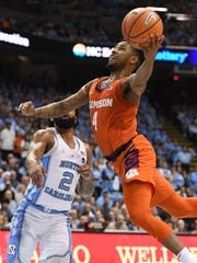 Clemson guard Shelton Mitchell (4) drives to the basket past North Carolina guard Joel Berry II (2) on Tuesday, January 14, 2018 at UNC's Smith Center in Chapel Hill, N.C.
