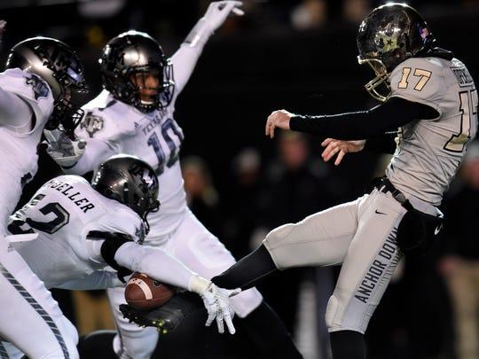 Texas A&M defensive back Sam Moeller (12) blocks a