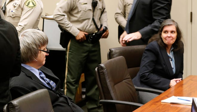David and Louise Turpin look art each other as they appear in court for a conference about their case in Riverside, Calif., Friday, Feb. 23, 2018. They have pleaded not guilty to torture and other charges and each is held on $12 million bail. The couple was arrested last month after their 17-year-old daughter escaped from the family's home in Perris, Calif., and called 911. (AP Photo/Damian Dovarganes, Pool)