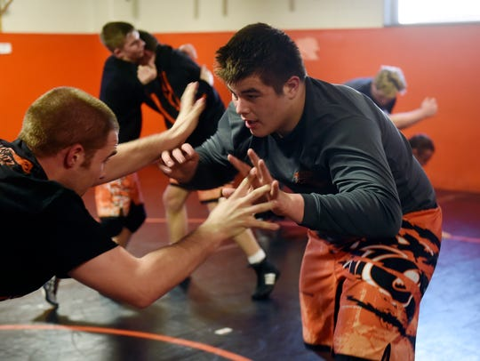 Central York wrestler Michael Wolfgram faces head coach
