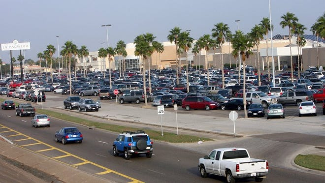 Shoppers pack the parking lot of the Shops at La Palmera during Black Friday.