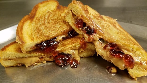 Peanut butter and jelly samdwich is taken to new heights by grilling tt.