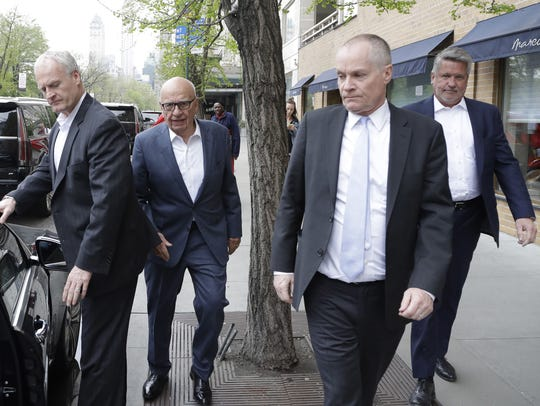 Rupert Murdoch, second from left, leaves a Manhattan restaurant with Fox News co-presidents Jack Abernethy, second from right, and Bill Shine, right, April 24, 2017, in New York. The man at left is unidentified. Trump recently named Shine deputy chief of staff to oversee White House communications and press teams.