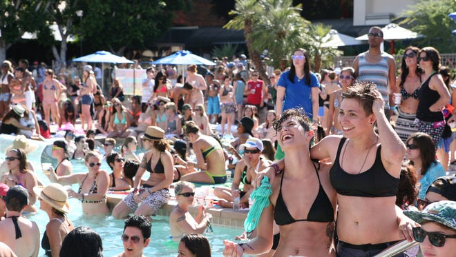 Hundreds of women gathered around the pool at the Hilton Palm Springs during the 2015 Dinah Weekend, which attracts thousands of lesbians to Palm Springs.