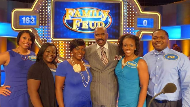 "From left, Cassie Smith, Ebony Cole, Shannon Randles, Ryan Jeans and  Natalie Jeans are shown with Steve Harvey, the host of ""Family Feud."""