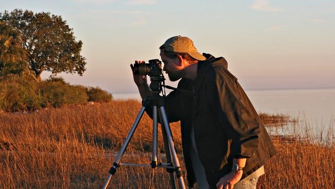 A photographer captures wildlife at St. Marks Wildlife Refuge.
