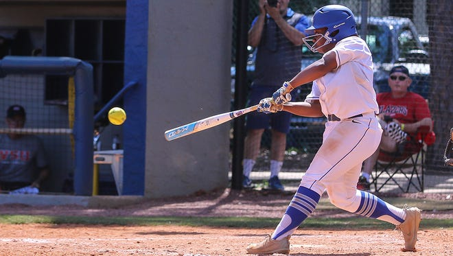 With the bases loaded in the bottom of the 7th inning, UWF's Tiona Hill (7) smashes the come-from-behind, game-winning 2-run hit into left field against Valdosta State during the NCAA Division II South 1 Regional Softball Tournament championship game at UWF on Saturday, May 13, 2017.