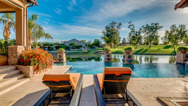 Bruce Arians, former head coach of the Arizona Cardinals, is selling his home in Chandler's Vistas at Ocotillo. The home features a vanishing edge infinity pool, which blends seamlessly into the lake and the surrounding Ocotillo Golf Course.