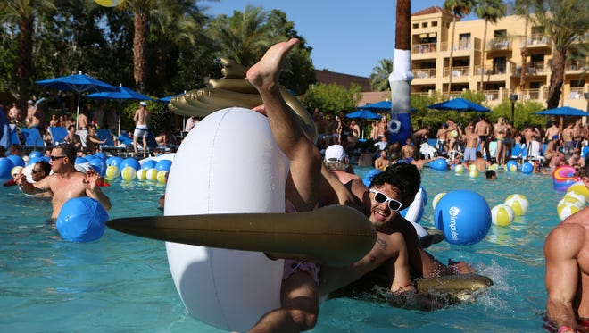 White Party Palm Springs revelers swim and dance during the Day Club Pool Party at The Renaissance Hotel in Palm Springs on Saturday, April 28, 2018.