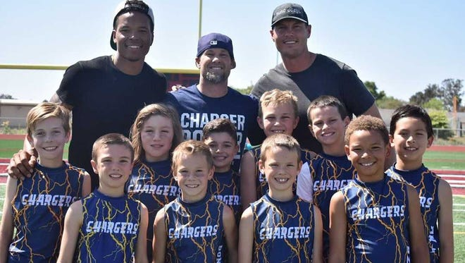 Lions receiver Marvin Jones, Chargers quarterback Philip Rivers and Ravens safety Eric Weddle join their players on the Chargers players.