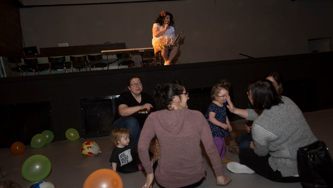 Dora Diamond, a Milwaukee drag performer, reads books at a Drag Queen Story Time.