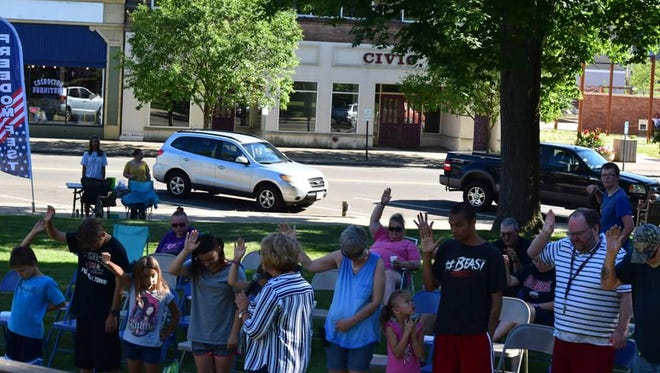 Members of the community and the River Coshocton Church gathered Sunday, in downtown Coshocton for the church's third Freedom Fest.