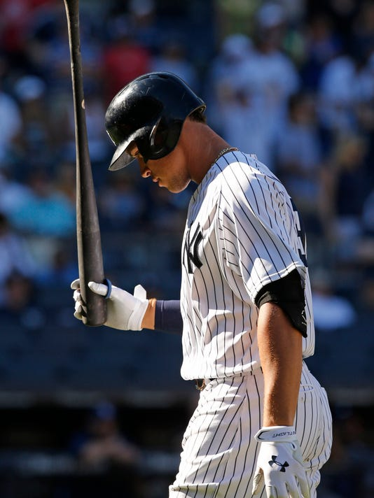 New York Yankees' Aaron Judge reacts after fouling out to first with two runners on base in the ninth inning of a baseball game against the Tampa Bay Rays in New York, Sunday, July 30, 2017. (AP Photo/Kathy Willens)