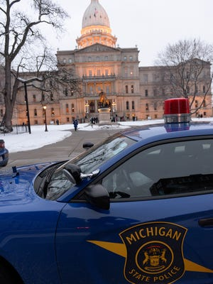 Security is tightened around the Capitol before Michigan Governor Rick Snyder speaks during his State of the State Address on the floor of the House at the Capitol in Lansing Tuesday 1/20/2015.t