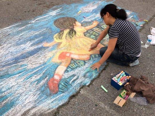 At the June 3-4, 2016 Chalk & Arts Festival, Shen Chen