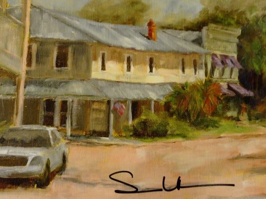 Apalachicola artist Susan Richardson's painting of Downtown Books in Apalachicola.