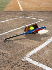 Softball, softball glove and bat at home plate