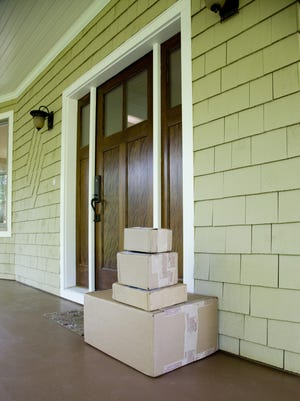 Stack of moving and/or mailing boxes by front door
