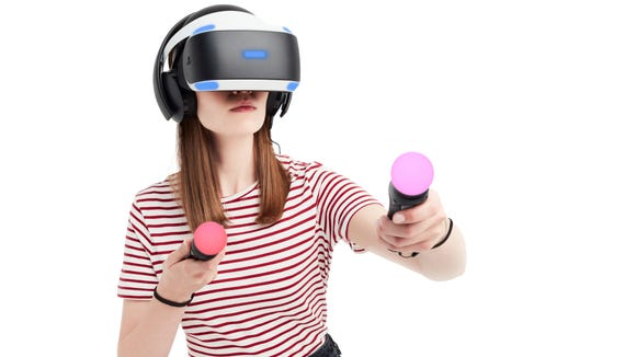 A woman playing PlayStation VR