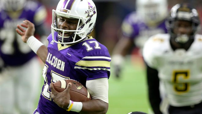 Alcorn State quarterback Lenorris Footman (17) carries the ball toward the end zone to score a touchdown during the first quarte of the SWAC Championship.