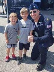 Air Force Maj. Stephen Del Bagno poses with West Melbourne brothers Hudson Rutherford, 4 (left), and Carson Rutherford, 5, during the Melbourne Air & Space Show.