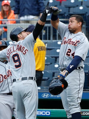Nicholas Castellanos, right, celebrates with Miguel Cabrera after hitting a two-run home run in the fourth inning in Pittsburgh, in Game 1 of a doubleheader Wednesday.