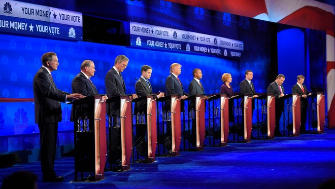 Republican presidential candidates, from left, John Kasich, Mike Huckabee, Jeb Bush, Marco Rubio, Donald Trump, Ben Carson, Carly Fiorina, Ted Cruz, Chris Christie, and Rand Paul take the stage during the CNBC Republican presidential debate at the University of Colorado, Wednesday, Oct. 28, 2015, in Boulder, Colo. (AP Photo/Mark J. Terrill)