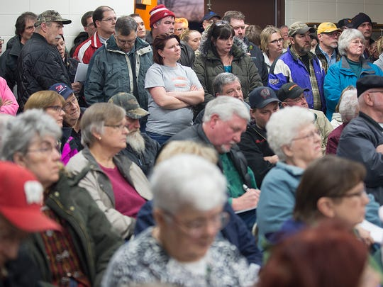 Members of the public gather to watch public comment during a meeting of the Protective Services Committee at Edwards Alexander Shelter in Port Edwards, Tuesday, March 1, 2016.
