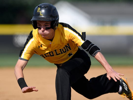Red Lion's Tyler Stabley makes a diving slide for a