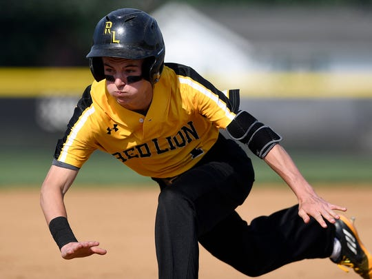 Red Lion's Tyler Stabley makes a diving slide for a triple against Dallastown District 3 Class 6-A baseball semifinal game at Spring Grove, Tuesday, May 29, 2018. John A. Pavoncello photo