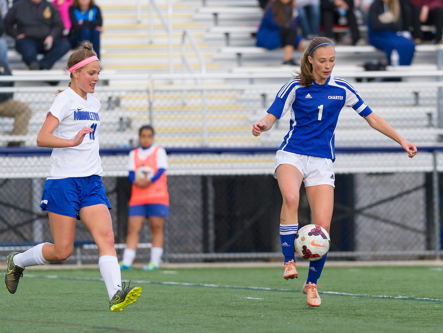 Sam Peters (1) of Charter tries to settle the ball as Alexandra Rodriguez (11) of Middletown approaches in a Charter at Middletown girls soccer game on Wednesday.