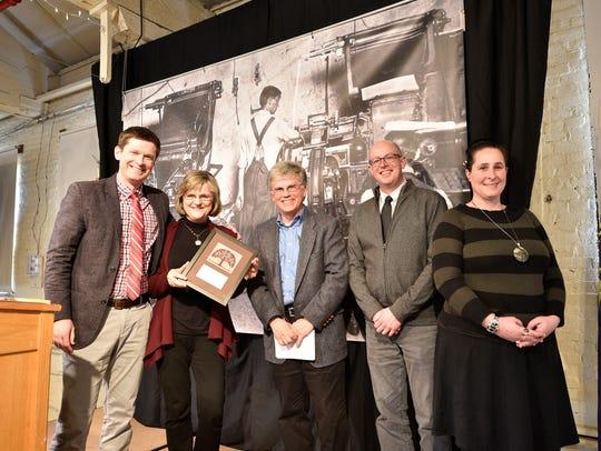 Salem Art Association members accept the Heritage Education