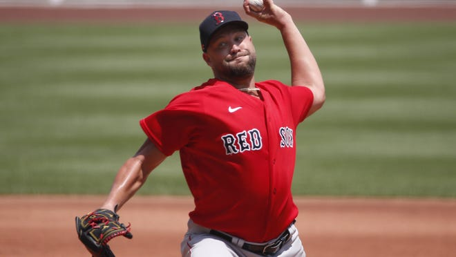 Pitcher Brian Johnson, shown delivering a pitch during training camp at Fenway Park on July 7, was released by the Boston Red Sox on Monday.