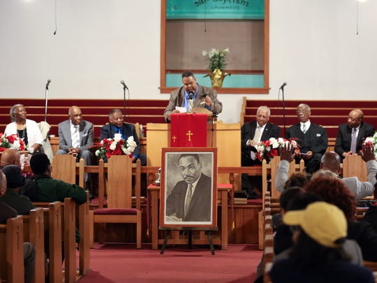 Rev. Michael A. Baston speaks during a Spring Valley