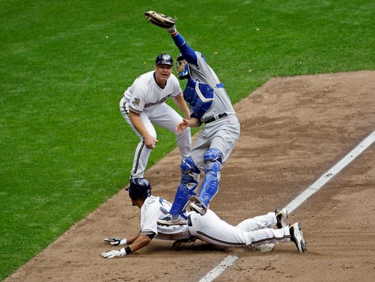 Carlos Gomez slides into third safely but ended up