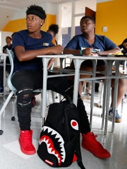 Xavier Paige, 14, watches a video that the class has