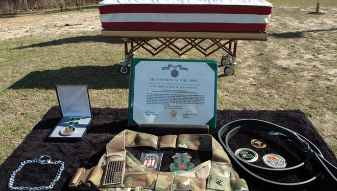 Max's collar, leash, gear and awards are on display during his memorial Jan. 27 at Fort Polk's Military Working Dog kennels.