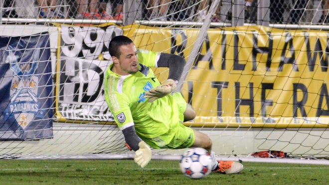Jun 14, 2014; Cary, NC, USA; Carolina Railhawks goalkeeper Scott Goodwin (12) saves a shot during the penalty shootout against Chivas USA during the US Open Cup fourth round at WakeMed Soccer Park. The Carolina Railhawks advanced 1-1 (3-2 on penalties) Mandatory Credit: Rob Kinnan-USA TODAY Sports