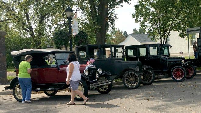Vintage automobiles line Minnesota Street in downtown St. Joseph as part of the Millstream Arts Festival Sunday, Sept. 24.