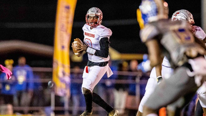 Jenkins quarterback Patrick Blake (2) looks back to pass during the GHSA Class 3A semifinal game last season at Crisp County in Cordele.