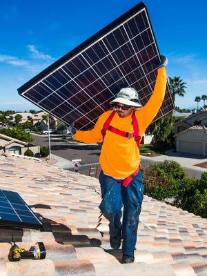 George Rocco of American Solar & Roofing installs panels on a Chandler home.