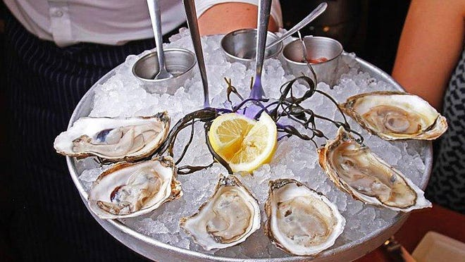 Oysters have long been a specialty at PB Catch, which now is open for both dine in and takeout. Even for takeout/pickup, customers can choose from about six varieties of oysters, served on ice with cocktail sauce, mignonette and lemon.