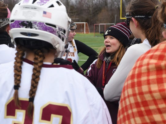 Jaclyn Murphy, head coach for Arlington High School's junior varsity girls lacrosse team, gives a pep talk during a break in Saturday's opening game at home against Monroe-Woodbury.