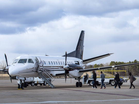 Passengers board a flight at the Plattsburgh International Airport on Friday, March 18, 2016. The airport is in the midst of a two-year expansion project.
