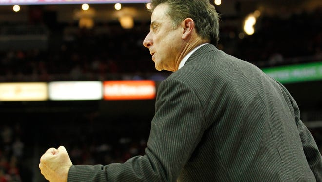 University of Louisville head coach Rick Pitino react to his teams play against Jacksonville State during the second half of play at the KFC Yum! Center in Louisville, Kentucky.       November 17, 2014
